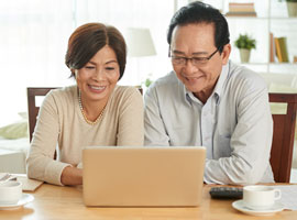 Older couple on laptop at home