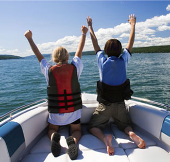 Young boy and girl enjoying boat trip
